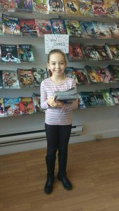 One of our customers with a HUGE pile of comics in her hands